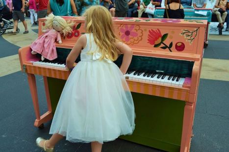 girl and doll Sing for Hope Pianos 2013