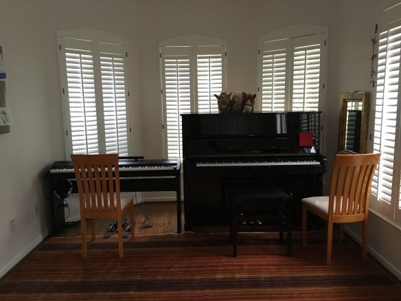 two pianos and plenty of room for movement, yet still cozy